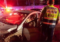 The sound of car hitting car, car hitting tree and glass bursting - in that order. (TheeErin) Tags: accident newyork unitedstates summer cervicalcollar hatzolah emt car collision ems emergency medical service outside lifesaving impact debris night caraccident mva