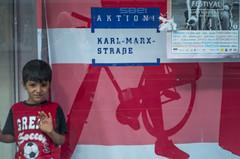Turkish youth integrated in window display. Neukölln, July 2016. (joelschalit) Tags: berlin germany deutschland immigration immigrants migrants minorities pentaxk01 turkey karlmarxstrase
