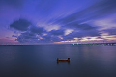 _40A4378 (ChefeGrande) Tags: sunrise longexposure movingclouds seashore woodpier fishingpier abandoned decaying serene coastal clouds sky reflection outdoor gulfcoast silhouette landscape lights