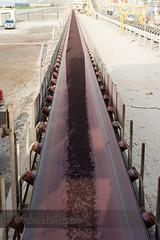 Transloading Iron Ore (rubared) Tags: belt marine jetty uae cargo abudhabi transportation shipping hopper unitedarabemirates discharge ironore esi mussafah transloading