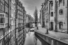 Downtown (McQuaide Photography) Tags: city windows urban blackandwhite bw holland reflection building window water netherlands monochrome amsterdam wall architecture canon eos mono canal blackwhite europe availablelight nederland naturallight oldbuildings ramen handheld daytime walls fullframe dslr residential 1740mm stad gebouw gracht muur lightroom 6d lseries canon6d mcquaidephotography