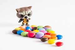 134/366: Hands off my sweeties! (judi may) Tags: white macro toy miniature mms dof candy whitebackground smarties tiny sweets sweeties candies rocketraccoon canon7d day134366 13may16 366the2016edition 3662016