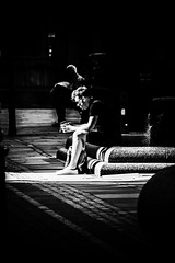 He found the sunny spot (tootdood) Tags: people blackandwhite manchester found sitting sunny spot sit sat seated stannssquare canon70d