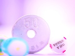 Smaller than a coin (tomoko mori) Tags: light macro japanese coin candy bright bokeh small tiny yen macromondays