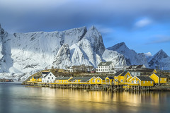 In the Golden Hour (Jerry Fryer) Tags: longexposure blue sky snow seascape water yellow norway clouds canon reflections landscape goldenhour daybreak lofotenislands rorbuer f4l snowcoveredmountains ef24105mm leefilters sakrisoya fishermanscottages 5dmk2 bigstopper