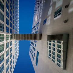 Shortcut to Justice (Paul Brouns) Tags: blue windows sky holland reflection building netherlands amsterdam wall architecture court paul justice pattern angle footbridge perspective palace lookingup lookup diagonal tiles connected asymmetry harmonica accordeon noord segments diagonally brouns paulbrouns paulbrounscom