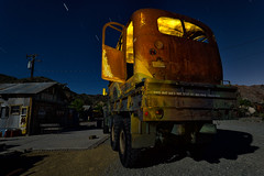 this bus does not stop. eldorado canyon, nv. 2016. (eyetwist) Tags: eyetwistkevinballuff eyetwist night truck bus madmax techatticupmine eldoradocanyon nelson nevada abandoned ruins dark longexposure long exposure fullmoon desert nikon d7000 nikkor capturenx2 1024mmf3545g npy nocturne highdesert americana americantypology american typology dead empty desolate lonely derelict decay nv wideangle 1024mm shadow mojavedesert ruin lightpainting yellow old vintage rust rusty southwest startrails star trails techatticup mine typography ghosttown touristtrap coloradoriver m939 6x6 military surplus camo schoolbus welded grafted contraption burningman apocalypse writing lettering railroadcrossing stop safetyfirst wheels