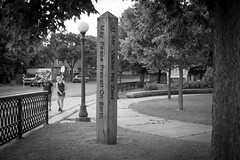 50105 May Peace Prevail (Rocks and Waters) Tags: street city urban bw minnesota zeiss midwest twincities saintpaul carlzeiss peacepole a7ii loxia maypeaceprevail sonyalpha loxia250 sonya7m2 loxf250mmloxiaf250
