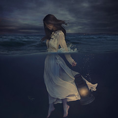 a light for tarnished souls (brookeshaden) Tags: ocean light selfportrait water underwater darkness surrealism lantern melancholy stormysky sinking whimsical select fineartphotography conceptualphotography halfunderwater fairytalephotography