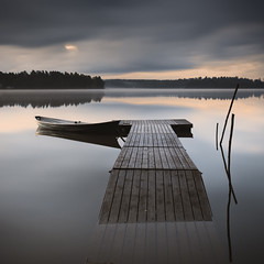Float (Vesa Pihanurmi) Tags: longexposure morning lake reflection water espoo landscape dawn boat sticks jetty tranquility calm rowboat serene swpa lakebodom sonyworldphotographyawards