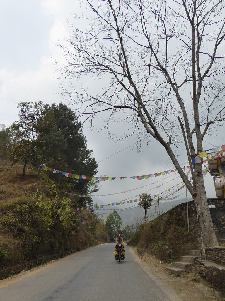 Riding below prayer flags