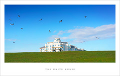 The white house (Parallax Corporation) Tags: sky seagulls white house grass clouds merseyside hallroad