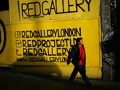 Shoreditch Red Gallery - London Street Photography (Nicholas Goodden) Tags: city red people urban color colour london yellow photography colorful candid citylife streetphotography vivid olympus shoreditch londres streetphoto colourful unposed londra urbanlife urbanphotography londoners streetphotographer photoderue notposed streetsoflondon urbanphotographer redgallery mirrorless microfourthirds