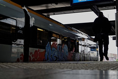 ([gegendasgrau]) Tags: city railroad light shadow people urban man station architecture train walking concrete person graffiti licht mood moody platform atmosphere eisenbahn railway bahnhof hauptbahnhof infrastructure architektur rue dsseldorf mainstation beton beks bahnsteig infrastruktur ambiance 2015 atmo eurobahn keolis stadlerflirt