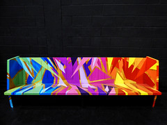 Struck By Rainbows (Steve Taylor (Photography)) Tags: city newzealand christchurch streetart colour art strange festival bench fun graffiti weird crazy cool rainbow neon spectrum seat vivid canterbury odd nz southisland colourful mad settle