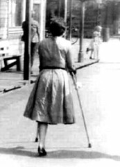 bw_13 1950s one legged crutcher (jackcast2015) Tags: handicapped disabled disabledwoman cripledwoman onelegwoman oneleggedwoman monopede amputee legamputee crutches
