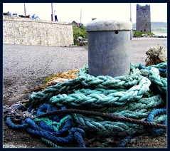 I could spend my life (Maewynia) Tags: ireland tower castle pier ropes achill bollard granuaile
