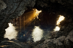 Ocean Water Drops (Raiatea Arcuri) Tags: sunset seascape rock hawaii cave bigisland sunrays waterdrops waikoloa