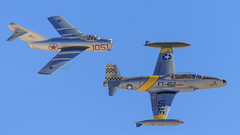 """Greg """"Wired"""" Colyer in the Lockheed T-33 Shooting Star """"Ace Maker II"""" and Chris """"Zippo"""" Fahey in the Mikoyan-Gurevich MiG-15 Fagot (Norman Graf) Tags: plane airplane fighter aircraft ace jet airshow ii maker lockheed performer pilot trainer warbird koreanwar aerobatics 1051 shootingstar t33 fagot mikoyangurevich aviationnation 21452 mig15bis t33a klsv n87cn gregwiredcolyer n133hh acemakerii ft452 2014nellisafbopenhouse chriszippofahey"""