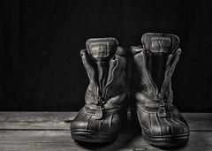 Winter Weary Workboots (lclower19) Tags: boots winter weary black white bw sb600 stilllife tabletop hss odc odt walking