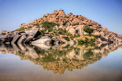 Reflections (criatvt) Tags: india mountain reflection water beauty river temple rocks religion bank boulder karnataka hindu hampi krishnadevaraya tungabadra