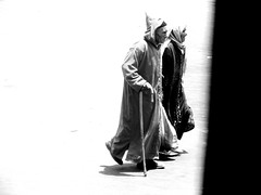 'The Way from Light into Darkness'. (Two Which Come To The End Of Their Long Lives). Allegories by Elena Savonicheva, 2015 (elenasavonicheva) Tags: africa road street old travel two portrait people blackandwhite woman man way photography photo blackwhite artwork couple dress streetphotography husband morocco step age maroc wife streetphoto local allegory oldage photopainting blackwhitephoto blackandwhitephoto travelphoto travelpics moroccans jellabas