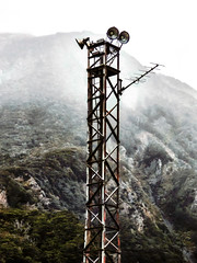 The Tall Tower (Steve Taylor (Photography)) Tags: light newzealand cloud mist mountain cold tower lamp station lightbulb metal fog rust aerial nz southisland ladder southernalps otira