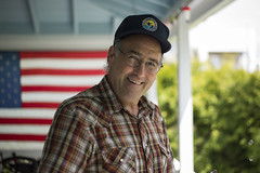 Mark (consolecadet) Tags: family portrait america outdoors naturallight americanflag porch outdoorportrait