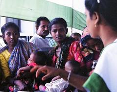 A woman social worker in a Dhaka slum (bokage) Tags: social worker dhaka bangladesh slum bokage