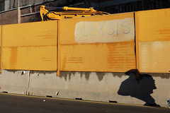 Under Construction (Jeffrey De Keyser) Tags: rome italy wall shadow yellow roma light sun man face construction viadelcolosseo wsp ons apf sic usp eye nge spw sph psp srm pis vog wsg tri x4 8