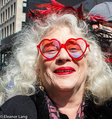 Photographer's Choice (Eleanor Lang) Tags: woman redlipstick easterparade redheartshapedglasses eleanorlang