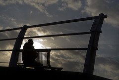 Caught in Silhouette (Greater Manchester Police) Tags: sky silhouette clouds bench prom promenade blackpool fylde maninhat blackpoolpromenade manonbench maninsilhouette