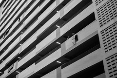 (ZQ.ow) Tags: street blackandwhite lines 50mm singapore geometry olympus flats