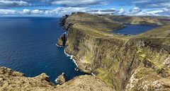 Faroese Cliffs (Bjartur Vest) Tags: blue sea sky cliff cloud cold ngc rocky vivid steep