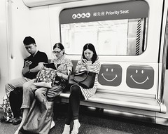 Rare photo opportunity. (hksleeper) Tags: morning man subway hongkong blackwhite women asia streetphotography rushhour rare mtr priorityseating communte smartography nexus6p