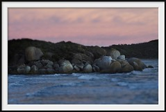 southern sentinels (Andrew C Wallace) Tags: ocean sea blur lensbaby rocks dof australia olympus victoria granite omd tidalriver tiltshift m43 whiskybay em5 nikon50mmf14 microfourthirds tilttransformer