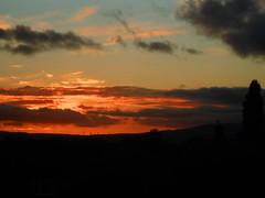 Embers of the day (Nibbler1977) Tags: sunset sky cloud sun silhouette set clouds evening sundown dusk silhouettes sunsets orangesky setting silhouetted nightfall