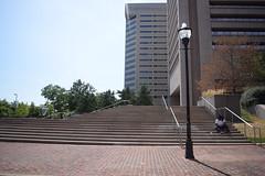 The Stairs (Sam DeGenova) Tags: baltimore buildings city cars sun shine reflections people street america