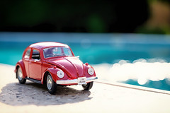 Beetle pool side (le cabri) Tags: old red sun sunlight cute water pool fashion germany volkswagen toy outdoors 60s europe beetle bluesky retro replica swimmingpool german transportation hippie volks iconic sixties toycar boken sunnyday frontview 1960 germanculture 60's 19601969 landvehicle retrostyled