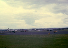 General view of US Military Aircraft at PRESTWICK 13JULY1964 (shipcard) Tags: airport otter boeing globemaster lockheed usnavy aew constellation prestwick usairforce airfield usarmy stratocruiser c124 dehavilandcanada july1964