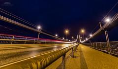 askybroen midt p (huddart_martin) Tags: road longexposure bridge norway night streetlights sony wideangle lighttrails bergen suspensionbridge hordaland asky askybroen a77rainy