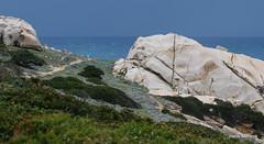 Walking the rocks (Hengelo Henk) Tags: sardegna sea italy water landscape rocks sardinia outdoor capo italie testa mediterranee sardini