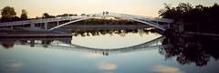 Parque Juan Carlos I (PHLARE) Tags: bridge sunset sunlight puente