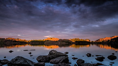 Sun after rain (Tommy Høyland) Tags: wood morning travel blue light sky panorama cloud lake reflection tree nature water beautiful stone sunrise landscape mirror golden early still scenery rocks quiet purple outdoor postcard country scene calm environment tranquil scandinavian sunligh