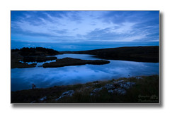 Dusk on the Isle of Lewis (Descended from Ding the Devil) Tags: blue sky reflection water grass clouds scotland rocks dusk loch isleoflewis hebrides canon30d photoborder 1785kitlens
