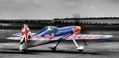 Flying Bull Extreme Air (Jonathan Saull) Tags: aviation aeroplane racing redbull aerobatics airdisplay iwmduxford redbullracing extremeair sportsplane olympusomdem1 olympusmzuiko1240mmedf28 olympusmzuiko40150ed28pro