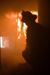 Fireman inspecting rire (Jeff Buchbinder) Tags: fire burn firefighter firefighters 50mmf14 canon5dmk3 denisrlemerytrainingcenter