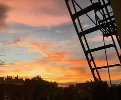 fire escape sunset (ekelly80) Tags: dc washingtondc summer july2016 sky sun sunset clouds view fireescape colors ladder pink orange