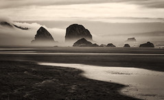 Mystical Shores (Irwin Scott) Tags: seascape misty oregon landscape coast cloudy sandy rocky stormy monotone canonbeach tolovanabeach pentaxk1