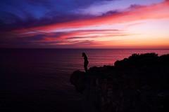 Standing at the edge (Darkroom Illusion) Tags: ocean sunset sky cliff portugal night clouds landscape sundown dusk atlanticocean cascais cloudscape